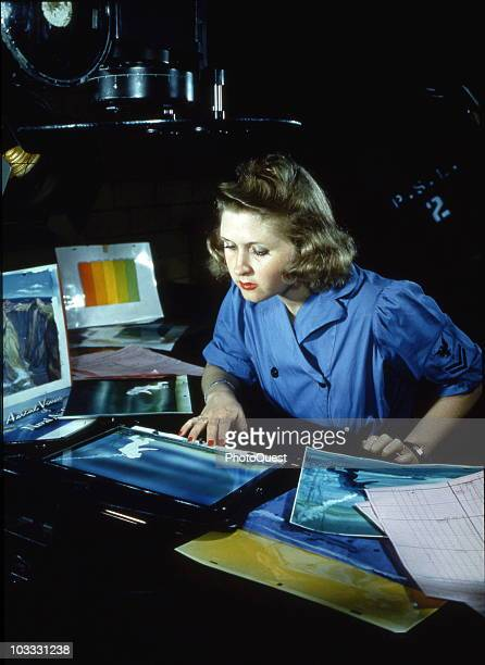'WAVE' Jean Selby makes celluloid transparencies for a deep sea diving training film at the Naval Photographic Laboratory in Anacostia DC during...
