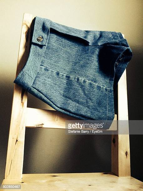 Jean shorts on wooden chair