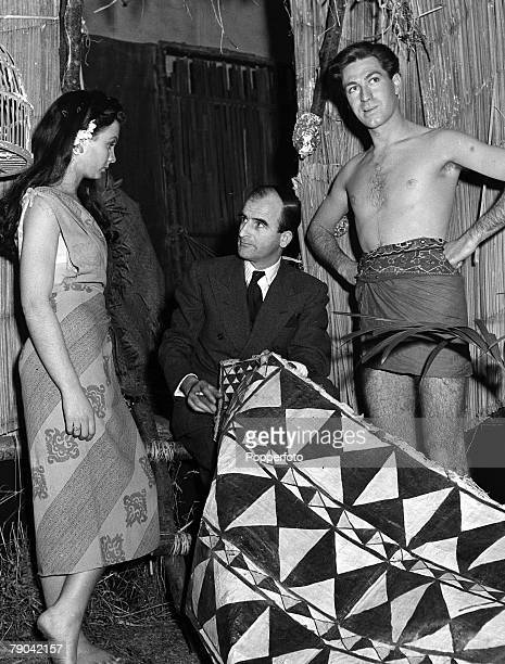 Jean Simmons wearing a sarong chats to Frank launder the director of the Film Blue Lagoon while on the set at Pinewood Studios Dermot Walsh stands by...