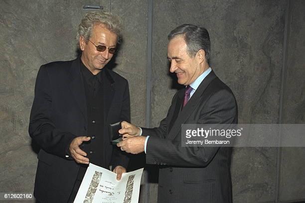 Jean Tiberi gives the city medal to Luc Plamondon