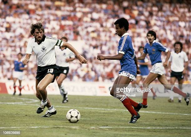Jean Tigana of France in action against Manfred Kaltz of West Germany during the 1982 FIFA World Cup Semi Final on 8th July 1982 at the Ramon Sanchez...