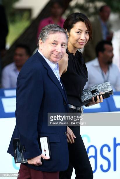 Jean Todt and girlfriend Michelle Yeoh arrive for the Grand Prix and Fashion Unite at The Amber Lounge Le Meridien Beach Plaza Hotel Monaco