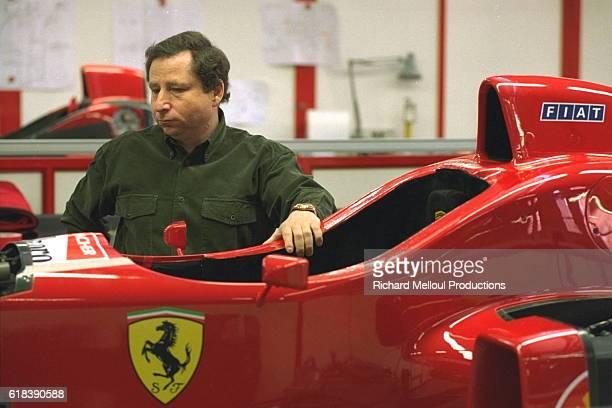 Jean Todt Ferrari Sports Director in front of a Ferrari F310