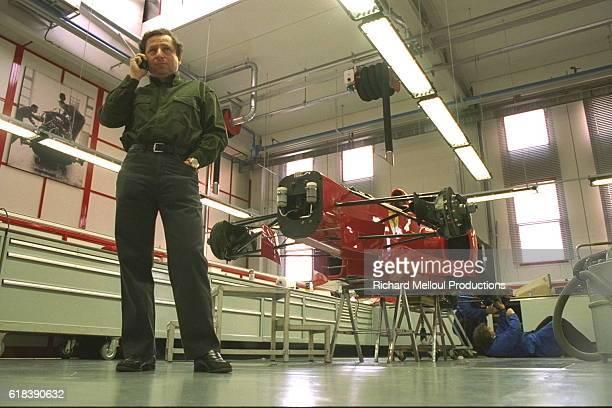 Jean Todt in front of a Ferrari F310