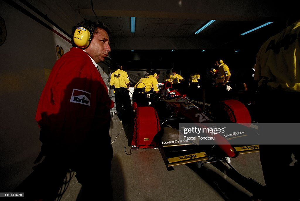<a gi-track='captionPersonalityLinkClicked' href=/galleries/search?phrase=Jean+Todt&family=editorial&specificpeople=206323 ng-click='$event.stopPropagation()'>Jean Todt</a>, Team Principal for Scuderia Ferrari oversees the preparation of Gerhard Berger's #28 Scuderia Ferrari SpA Ferrari F93A during practice for the Portuguese Grand Prix on 25th September 1993 at the Autodromo do Estoril in Estoril, Portugal.