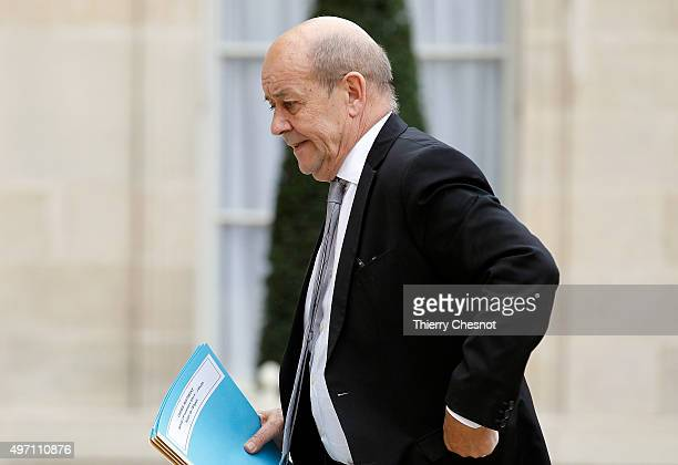 Jean Yves Le Drian French Minister of Defence arrives at the Elysee Palace in Paris for a crisis cabinet meeting on November 14 2015 in Paris France...