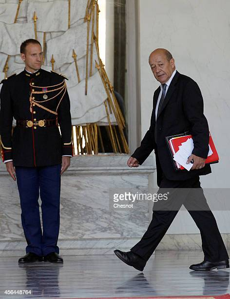 Jean Yves Le Drian French Minister of Defence leaves the Elysee Palace after a weekly cabinet meeting on October 1 2014 in Paris France Francois...