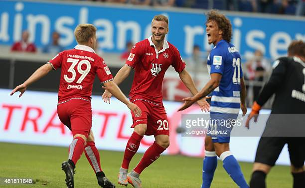 Jean Zimmer of Kaiserslautern celebrates with Kacper Przybylko near Rolf Feltscher of Duisburg after scoring the second goal during the 2nd...