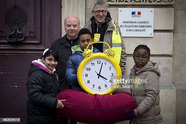 JeanBaptiste Eyraud president of French housing advocacy organization 'Droit au Logement' former French bishop Jacques Gaillot pose with three...