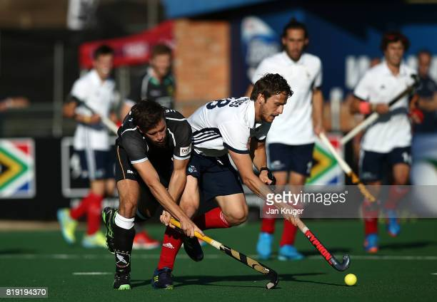 JeanBaptiste Forgues of France battles with Martin Zwicker of Germany during day 6 of the FIH Hockey World League Men's Semi Finals quarter final...