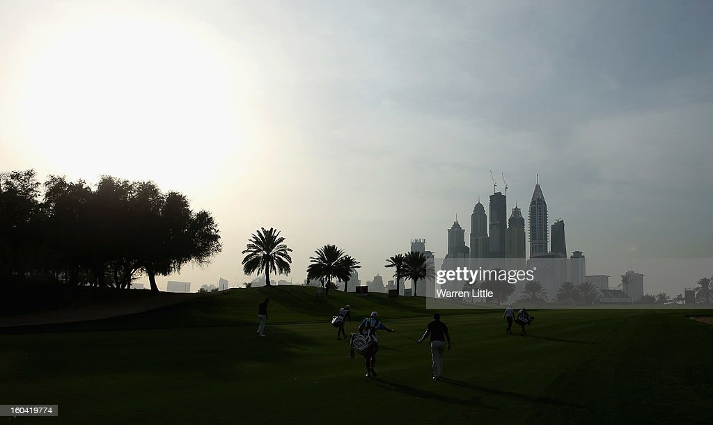 Jean-Baptiste Gonnet of France passes his club to his caddie during the first round of the Omega Dubai Desert Classic at Emirates Golf Club on January 31, 2013 in Dubai, United Arab Emirates.