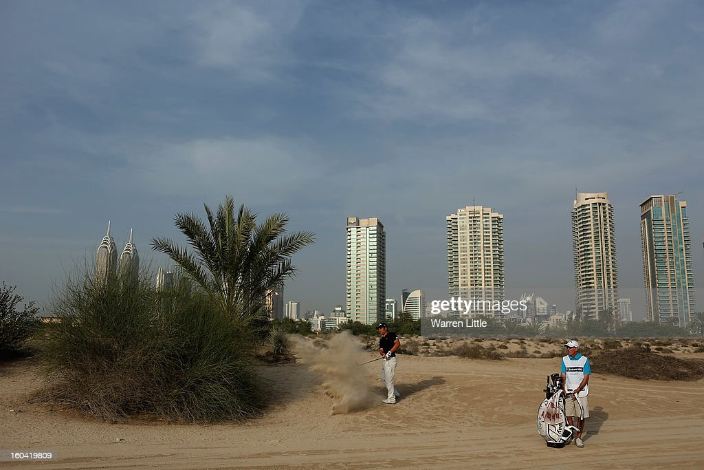 Jean-Baptiste Gonnet of France plays out of the sand during the first round of the Omega Dubai Desert Classic at Emirates Golf Club on January 31, 2013 in Dubai, United Arab Emirates.