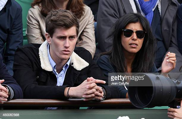 JeanBaptiste Maunier and Reem Kherici attend Day 11 of the French Open 2014 held at RolandGarros stadium on June 4 2014 in Paris France
