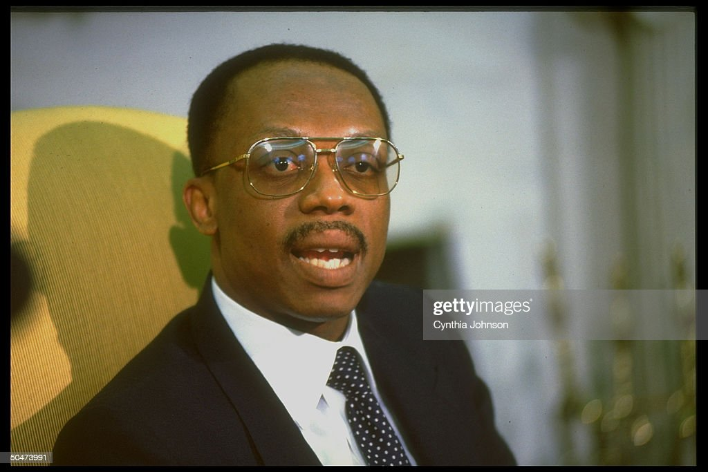 Jean-Bertrand Aristide, deposed democratically-elected pres. of Haiti, during WH Oval Office mtg. w. Pres. Clinton re restoring him to office.