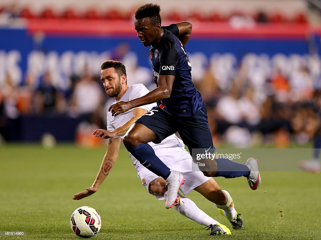 Jean-Christophe Bahebeck #15 of Paris Saint-Germain takes the ball as Gonzalo Rodriquez #2 of AFC Fiorentina defends during the International Champions Cup at Red Bull Arena on July 21, 2015 in Harrison, New Jersey.Paris Saint-Germain defeated ACF Fiorentina 4-2.