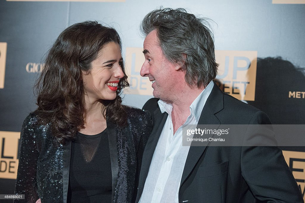 Jean-Christophe Grange (R) and friend attend 'The Wolf of Wall Street' photocall at Palais Brogniart on December 9, 2013 in Paris, France.