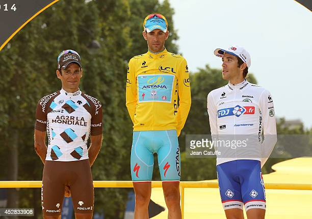JeanChristophe Peraud of France and AG2R La Mondiale second of the Tour Vincenzo Nibali of Italy and Astana Pro Team winner of the Tour and Thibaut...