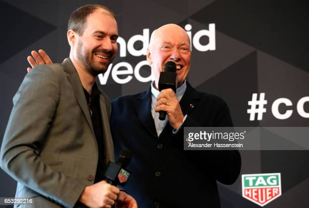 JeanClaude Biver CEO of TAG Heuer and President of the LVMH Watch Division talks to David Singleton VicePresident of AndroidEngineering Google during...