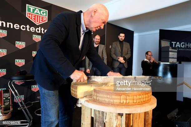 JeanClaude Biver CEO of TAG Heuer and President of the LVMH Watch Division cut his own cheese after a press conference at the international launch of...