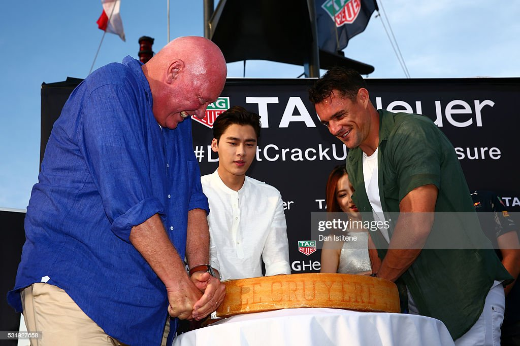 Jean-Claude Biver, CEO of TAG Heuer, cuts some cheese on stage at a TAG Heuer event in Port Hercule de Monaco with Dan Carter, rugby player, <a gi-track='captionPersonalityLinkClicked' href=/galleries/search?phrase=Max+Verstappen&family=editorial&specificpeople=12813205 ng-click='$event.stopPropagation()'>Max Verstappen</a> of Netherlands and Red Bull Racing, Li Yifeng, actor, and G.E.M, singer, on May 28, 2016 in Monaco, Monaco.