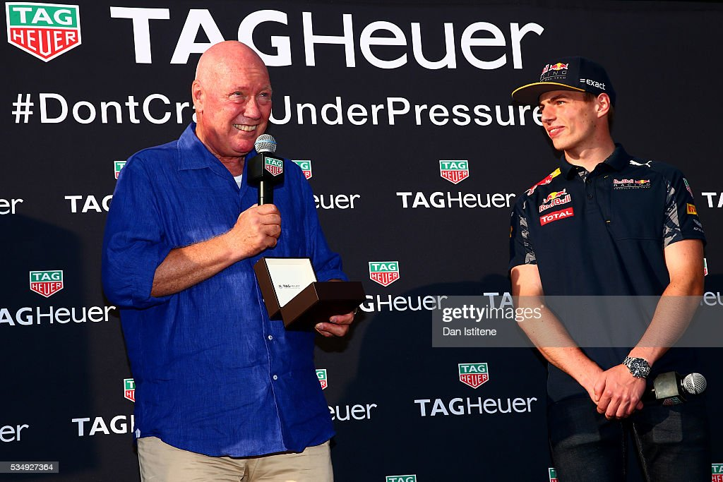 Jean-Claude Biver, CEO of TAG Heuer presents <a gi-track='captionPersonalityLinkClicked' href=/galleries/search?phrase=Max+Verstappen&family=editorial&specificpeople=12813205 ng-click='$event.stopPropagation()'>Max Verstappen</a> of Netherlands and Red Bull Racing with a new watch at a TAG Heuer event in Port Hercue de Monaco on May 28, 2016 in Monaco, Monaco.