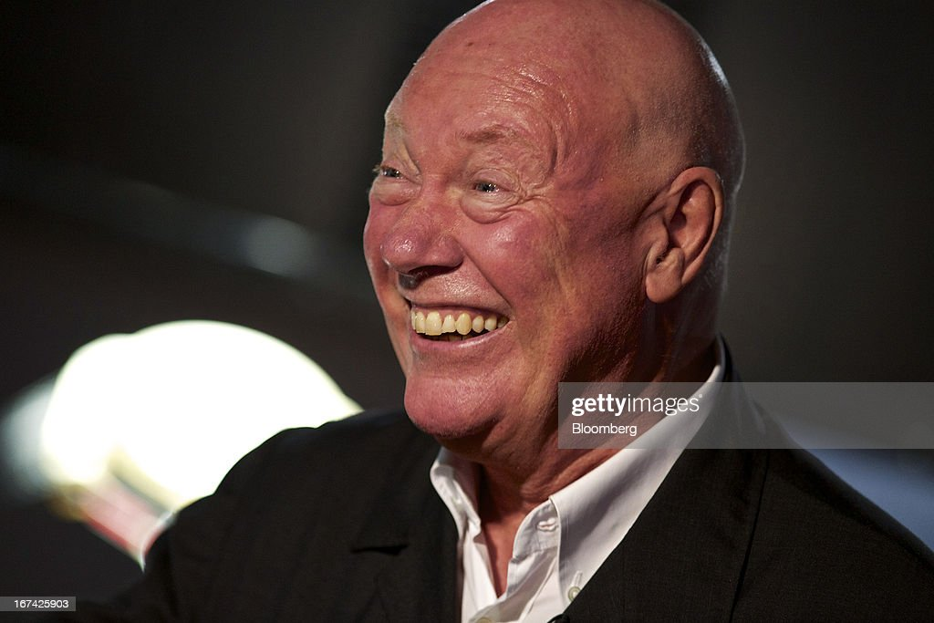 Jean-Claude Biver, chairman of Hublot SA, a watchmaking unit of LVMH Moet Hennessy Louis Vuitton SA, reacts during a Bloomberg television interview at the Baselworld watch fair in Basel, Switzerland, on Thursday, April 25, 2013. The annual fair attracts 2,000 companies from the watch, jewelry and gem industries to show their new wares to more than 100,000 visitors. Photographer: Gianluca Colla/Bloomberg via Getty Images