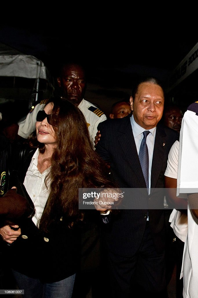 <a gi-track='captionPersonalityLinkClicked' href=/galleries/search?phrase=Jean-Claude+Duvalier&family=editorial&specificpeople=2596261 ng-click='$event.stopPropagation()'>Jean-Claude Duvalier</a> (R), the former Haitian leader 'Baby Doc', arrives at the airport with companion Veronique Roy (L) on January 16, 2011 in Port-au-Prince, Haiti. Duvalier was greeted by supporters upon returning to his homeland for the first time in 25 years from his exile in France.