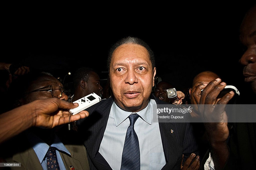 <a gi-track='captionPersonalityLinkClicked' href=/galleries/search?phrase=Jean-Claude+Duvalier&family=editorial&specificpeople=2596261 ng-click='$event.stopPropagation()'>Jean-Claude Duvalier</a> (C), the former Haitian leader 'Baby Doc', arrives at the airport on January 16, 2011 in Port-au-Prince, Haiti. Duvalier was greeted by supporters upon returning to his homeland for the first time in 25 years from his exile in France.