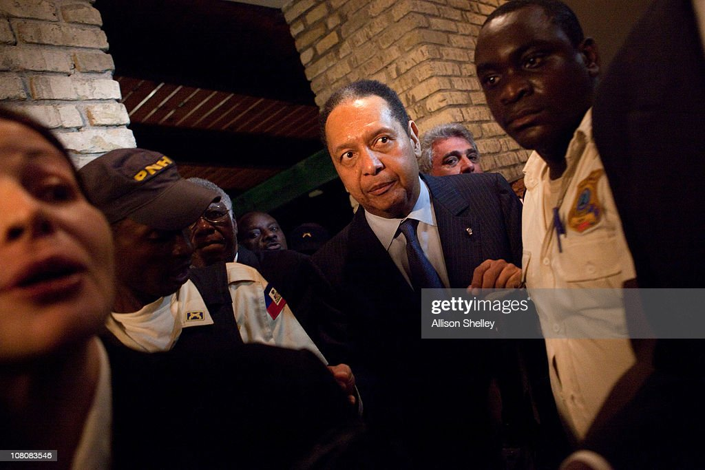 <a gi-track='captionPersonalityLinkClicked' href=/galleries/search?phrase=Jean-Claude+Duvalier&family=editorial&specificpeople=2596261 ng-click='$event.stopPropagation()'>Jean-Claude Duvalier</a>, the former Haitian leader known as 'Baby Doc', makes his way through the Karibe Hotel on January 16, 2011 in Port-au-Prince, Haiti. Duvalier was greeted by supporters upon returning to his homeland for the first time in 25 years from his exile in France.