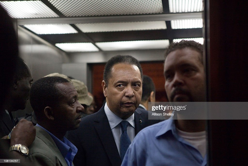 <a gi-track='captionPersonalityLinkClicked' href=/galleries/search?phrase=Jean-Claude+Duvalier&family=editorial&specificpeople=2596261 ng-click='$event.stopPropagation()'>Jean-Claude Duvalier</a> (C), the former Haitian leader known as 'Baby Doc', takes an elevator to his room in the Hotel Karibe after being questioned by Haitian authorities at a downtown courthouse January 18, 2011 in Port-au-Prince, Haiti. Duvalier was initially greeted by supporters upon returning to his homeland for the first time in 25 years from his exile in France. Duvalier was taken to a downtown courthouse and Haitian authorities presumably questioned Duvalier to determine whether he should be prosecuted for stealing from the treasury during his rule and for crimes against humanity.