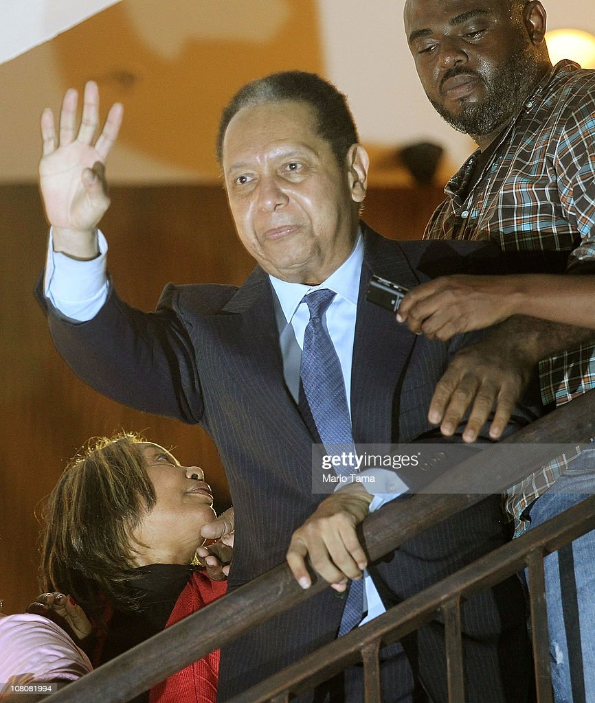 <a gi-track='captionPersonalityLinkClicked' href=/galleries/search?phrase=Jean-Claude+Duvalier&family=editorial&specificpeople=2596261 ng-click='$event.stopPropagation()'>Jean-Claude Duvalier</a>, the former Haitian leader known as 'Baby Doc', waves to supporters from a balcony of the Hotel Karibe on January 16, 2011 in Port-au-Prince, Haiti. Duvalier was greeted by supporters upon returning to his homeland for the first time in 25 years from his exile in France.