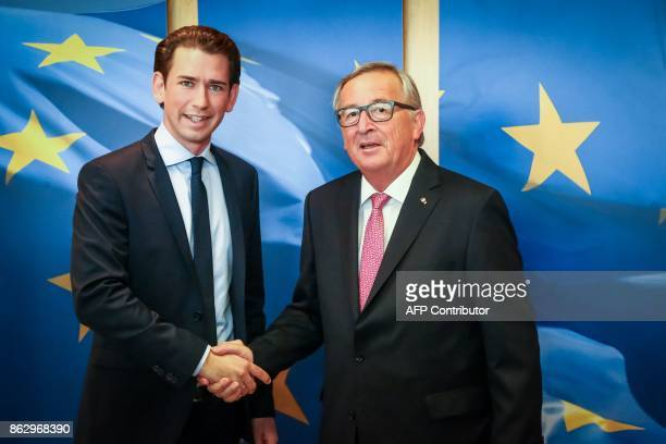 JeanClaude Juncker European Commission President shakes hands with Sebastian Kurz Austrian Minister of Foreign Affairs and leader of the Austrian...