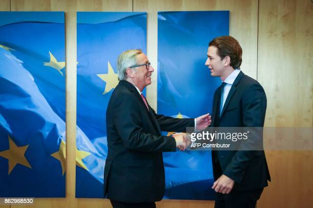 TOPSHOT JeanClaude Juncker European Commission President shakes hands with Sebastian Kurz Austrian Minister of Foreign Affairs and leader of the...