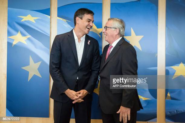 JeanClaude Juncker European Commission President welcomes Pedro Sanchez leader of the Spanish Socialist Workers' Party in Brussels on October 19 2017...