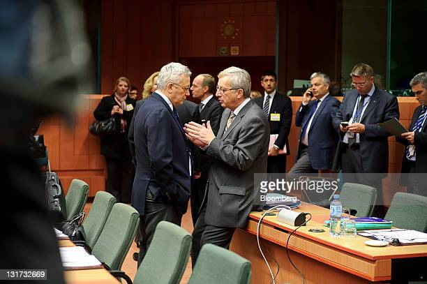 JeanClaude Juncker Luxembourg's prime minister and president of the Eurogroup right speaks with Giulio Tremonti Italy's finance minister during the...