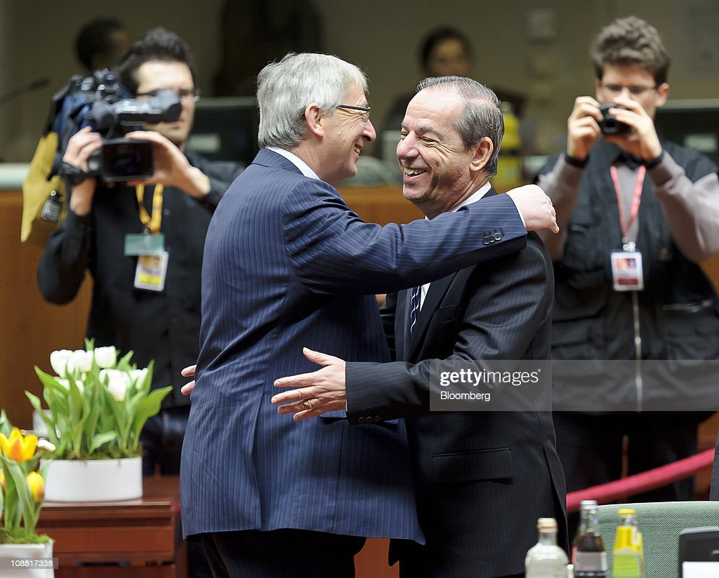 JeanClaude Juncker Luxembourg's prime minister left greets Lawrence Gonzi Malta's prime minister during the European Union Summit at the European...