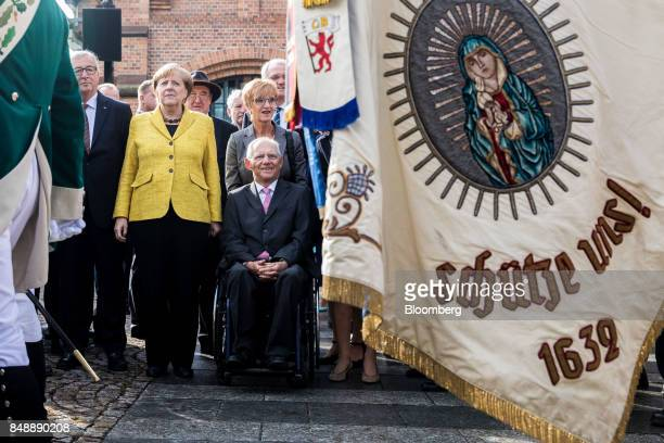 JeanClaude Juncker president of the European Commission left Angela Merkel Germany's chancellor and Christian Democratic Union leader center and...
