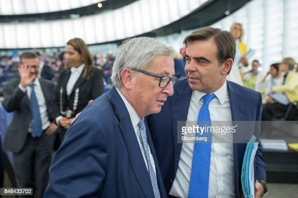 JeanClaude Juncker president of the European Commission left speaks with Margaritis Schinas chief spokesman of the European Commission following the...