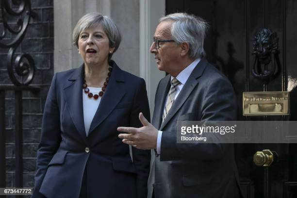 JeanClaude Juncker president of the European Commission right talks with Theresa May UK prime minister outside number 10 Downing Street in London UK...