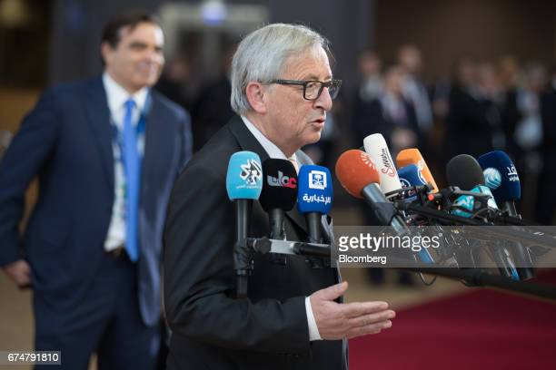 JeanClaude Juncker president of the European Commission speaks to members of the media as he arrives for a European Union leaders emergency Brexit...