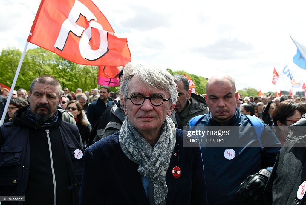 Jean-Claude Mailly of Force Ouvriere (FO) union looks on during a demonstration against the government's planned labour law reforms on May 3, 2016, in Paris as French lawmakers begin to examine the contested labour reform bill at the Parliament. Unions fear it will erode the cherished rights of workers on full-time contracts, while student organisations -- who have been at the forefront of the protests -- believe it will fail to create 'real' jobs for young people.