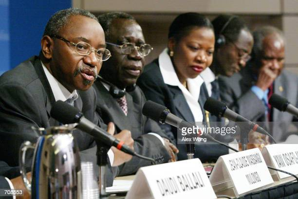 JeanClaude Massangu Mulongo Governor of the Central Bank of Congo speaks as Yaw OsafoMaafo Minister of Finance and Economy of Ghana Lucie Mboto Fouda...