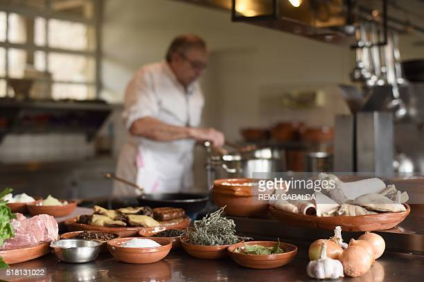 JeanClaude Rodriguez head chef of the restaurant Chateau Saint Martin in Carcassonne prepares a cassoulet in the restaurant's kitchen on March 4 2016...