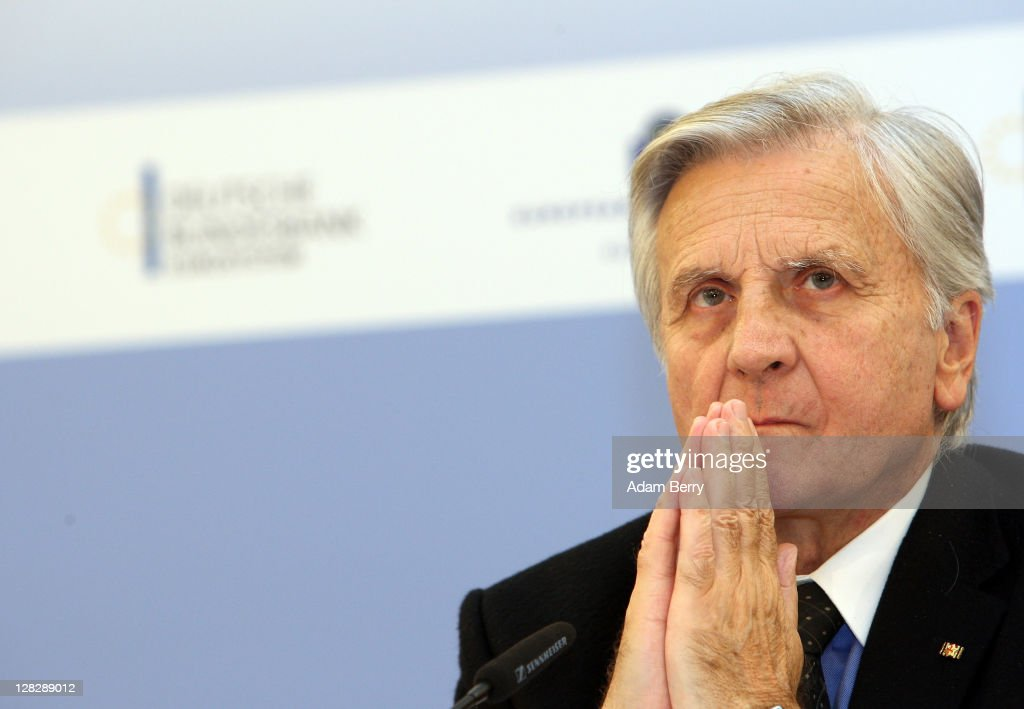 <a gi-track='captionPersonalityLinkClicked' href=/galleries/search?phrase=Jean-Claude+Trichet&family=editorial&specificpeople=208778 ng-click='$event.stopPropagation()'>Jean-Claude Trichet</a>, president of the European Central Bank, arrives to speak to reporters at a press conference following a meeting of the ECB Governing Council on October 6, 2011 in Berlin, Germany. Trichet and other world financial leaders, including Christine Lagarde, Director of the International Monetary Fund, and Robert Zoellick, President of the World Bank, are scheduled to meet later in the day in Berlin to discuss measures to counter the growing European debt crisis.