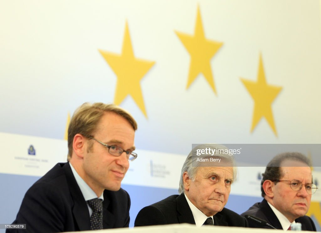 <a gi-track='captionPersonalityLinkClicked' href=/galleries/search?phrase=Jean-Claude+Trichet&family=editorial&specificpeople=208778 ng-click='$event.stopPropagation()'>Jean-Claude Trichet</a>, president of the European Central Bank (C), Jens Weidmann, president of the Bundesbank (L) and Vitor Manuel Ribeiro Constancio, vice-president of the European Central Bank, listen to a reporter's question at a press conference following a meeting of the ECB Governing Council on October 6, 2011 in Berlin, Germany. Trichet and other world financial leaders, including Christine Lagarde, Director of the International Monetary Fund, and Robert Zoellick, President of the World Bank, are scheduled to meet later in the day in Berlin to discuss measures to counter the growing European debt crisis.