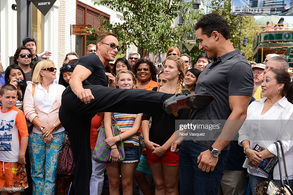 <a gi-track='captionPersonalityLinkClicked' href=/galleries/search?phrase=Jean-Claude+Van+Damme&family=editorial&specificpeople=566465 ng-click='$event.stopPropagation()'>Jean-Claude Van Damme</a> (L) and <a gi-track='captionPersonalityLinkClicked' href=/galleries/search?phrase=Mario+Lopez&family=editorial&specificpeople=235992 ng-click='$event.stopPropagation()'>Mario Lopez</a> visit 'Extra' at The Grove on August 16, 2012 in Los Angeles, California.