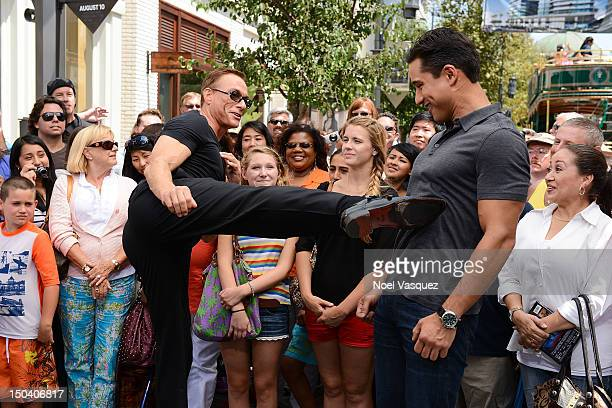 JeanClaude Van Damme and Mario Lopez visit 'Extra' at The Grove on August 16 2012 in Los Angeles California