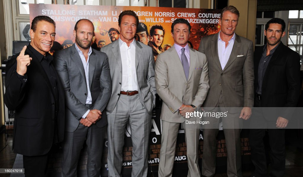 L-R <a gi-track='captionPersonalityLinkClicked' href=/galleries/search?phrase=Jean-Claude+Van+Damme&family=editorial&specificpeople=566465 ng-click='$event.stopPropagation()'>Jean-Claude Van Damme</a>, <a gi-track='captionPersonalityLinkClicked' href=/galleries/search?phrase=Jason+Statham&family=editorial&specificpeople=217567 ng-click='$event.stopPropagation()'>Jason Statham</a>, <a gi-track='captionPersonalityLinkClicked' href=/galleries/search?phrase=Arnold+Schwarzenegger&family=editorial&specificpeople=156406 ng-click='$event.stopPropagation()'>Arnold Schwarzenegger</a>, <a gi-track='captionPersonalityLinkClicked' href=/galleries/search?phrase=Sylvester+Stallone&family=editorial&specificpeople=202604 ng-click='$event.stopPropagation()'>Sylvester Stallone</a>, <a gi-track='captionPersonalityLinkClicked' href=/galleries/search?phrase=Dolph+Lundgren&family=editorial&specificpeople=216371 ng-click='$event.stopPropagation()'>Dolph Lundgren</a> and <a gi-track='captionPersonalityLinkClicked' href=/galleries/search?phrase=Scott+Adkins&family=editorial&specificpeople=9001376 ng-click='$event.stopPropagation()'>Scott Adkins</a> attend a photocall for The Expendables 2 at Simpsons On The Strand on August 13, 2012 in London, England.