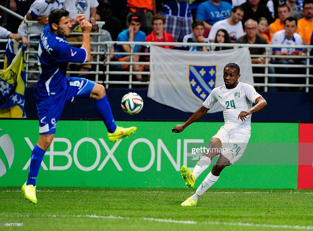Jean-Daniel Akpa Akpro #24 of the Ivory Coast shoots as Sead Kolasinac #5 of the Bosnia-Herzegovina defends during the first half of a friendly match at Edward Jones Dome on May 30, 2014 in St. Louis, Missouri. Bosnia-Herzegovina defeated Ivory Coast 2-1.