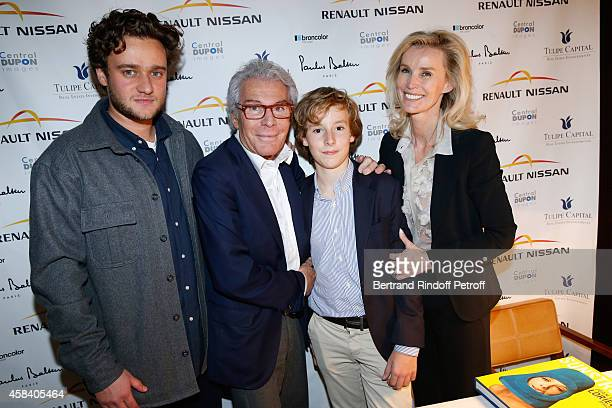 JeanDaniel Lorieux his companion Laura Restelli with sons Nicolas and Alexandre attend JeanDaniel Lorieux signs his Book 'Sunstroke' at the Art...